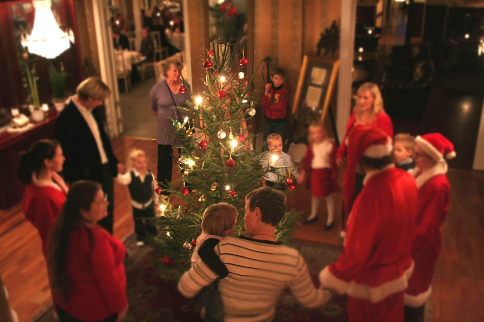 singing under the christmas tree - Who Celebrates Christmas