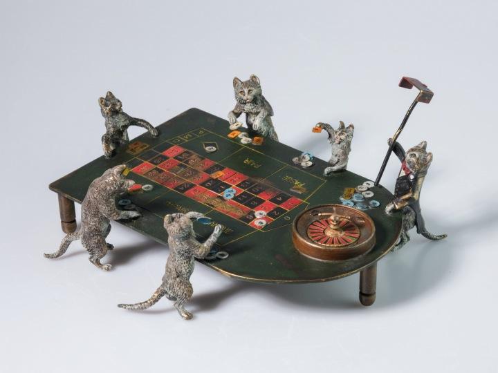 Kočky hrající ruletu.