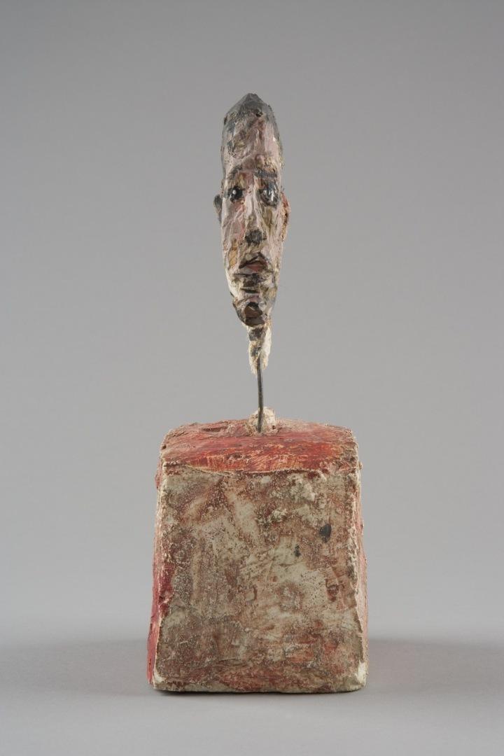 Hlava muže na podstavci, Alberto Giacometti .
