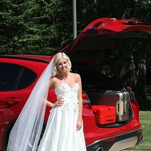 Šaty Sandra Mark, kufry Rimowa
